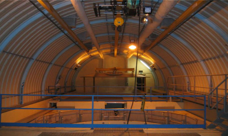 Picture of the Double Chooz-far detector site taken in September 2003. The original CHOOZ laboratory hall constructed by EdF, located close the old Chooz A underground power plant, is still in perfect condition and could be re-used without additional civil engineering construction.