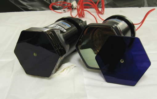 PMT assembly of the TA's new FD cameras calibrated by CRAYS. The BG3 filter contacts the PMT glass window with a thin air gap. On the right, the BG3 filter is removed from the PMT. An embedded YAP pulser can be seen at the center of the BG3 filter.