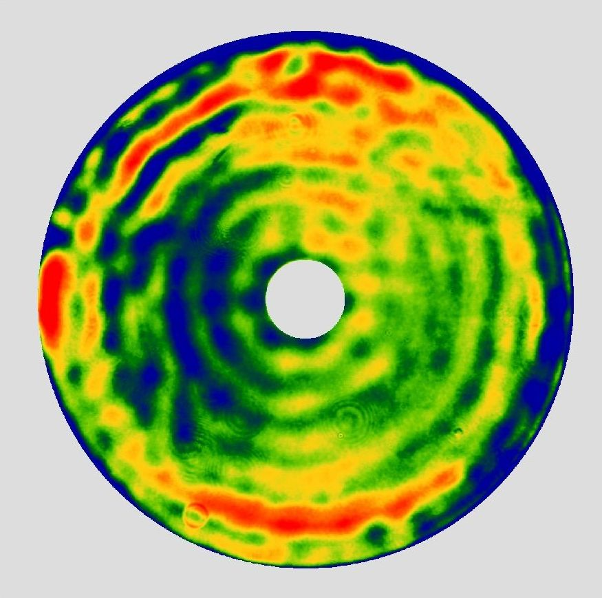 Transmission interferogram of the NIAOT trim plate fabricated for ZTF. The scale is linear with P-V(99%) = 0.57 waves at 632.8nm. The RMS transmitted wavefront error is 0.09 waves at 632.8nm. (courtesy C. Xu, NIAOT)