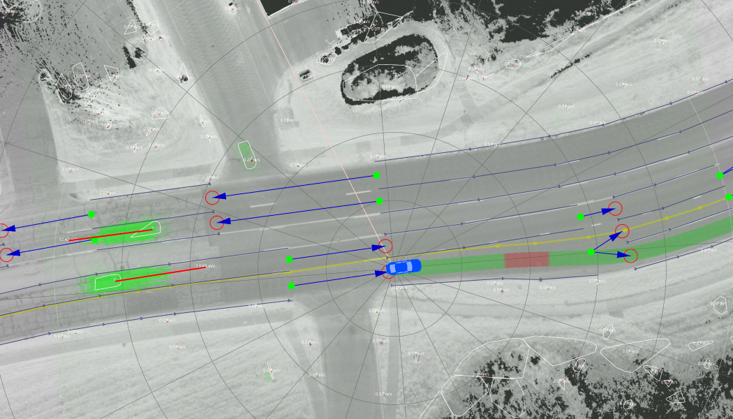 Tracker Integration Result. The green lines represent the flow vectors for each grid cell. The red lines represent the aggregated velocity for each object. This image demonstrates how static environmental objects do not get spurious velocities despite being observed from a moving platform, once our method is applied.