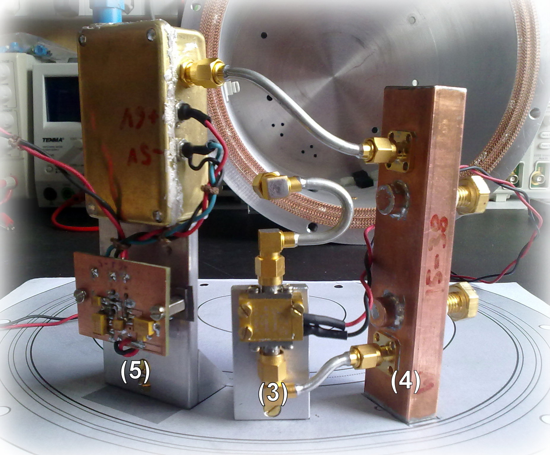 The components of the RF frontend, unmounted from the cavity shielding box. From left to right: Analog optical link, low noise amplifier and bandpass filter.