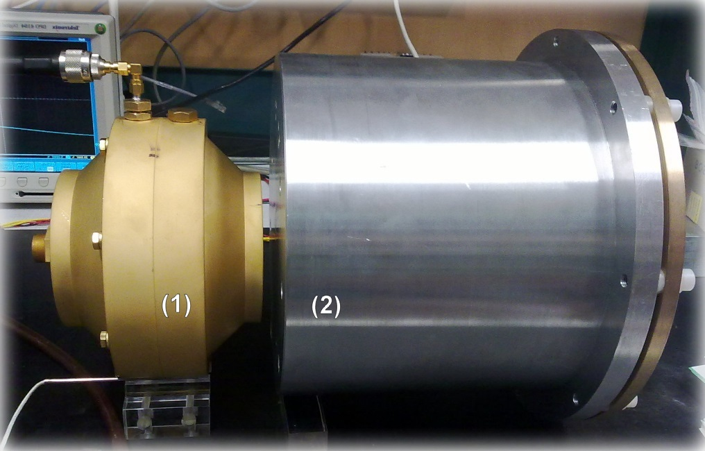 Photo of emitting cavity (1) and shielding enclosure (2) containing the identical detecting cavity. For ALP search, both parts were placed in the bore of a solenoid magnet with the same arrangement as shown in the picture.