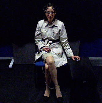 Participant in experiment conditions during the short videos experiment recorded in (a) Frontal HD video, (b) full body RGB video via Kinect, (c) full body depth video via Kinect; and group of 4 participants during the long videos experiment recorded in (d) frontal HD video, (e) full body RGB video via Kinect and (f) full body depth video via Kinect.