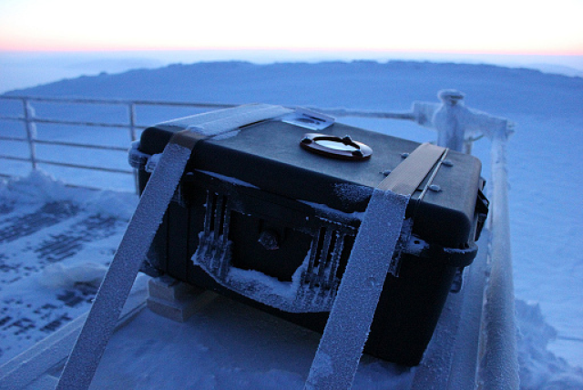 One of the camera enclosures mounted at the Ridge Lab and aligned to the North Celestial Pole. Ice has accumulated around the sides of the case and its surroundings, while the optical window is kept clear of contamination by the heating system.